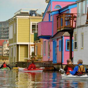 Kayaking along the floathomes at Fisherman's Wharf, Victoria, BC