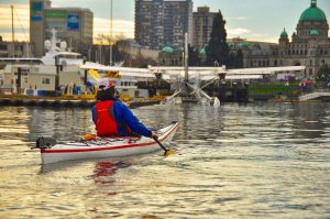 Kayaker & floatplane in Victoria Harbour. BC