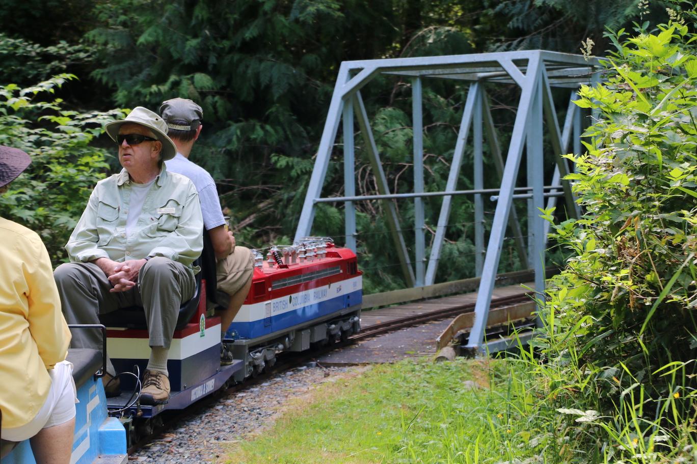 Model train approaching bridge